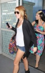 Miley Cyrus Looks Very Happy At JFK Airport