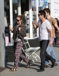 Miley Cyrus Strolls Around With Pup And Boyfriend